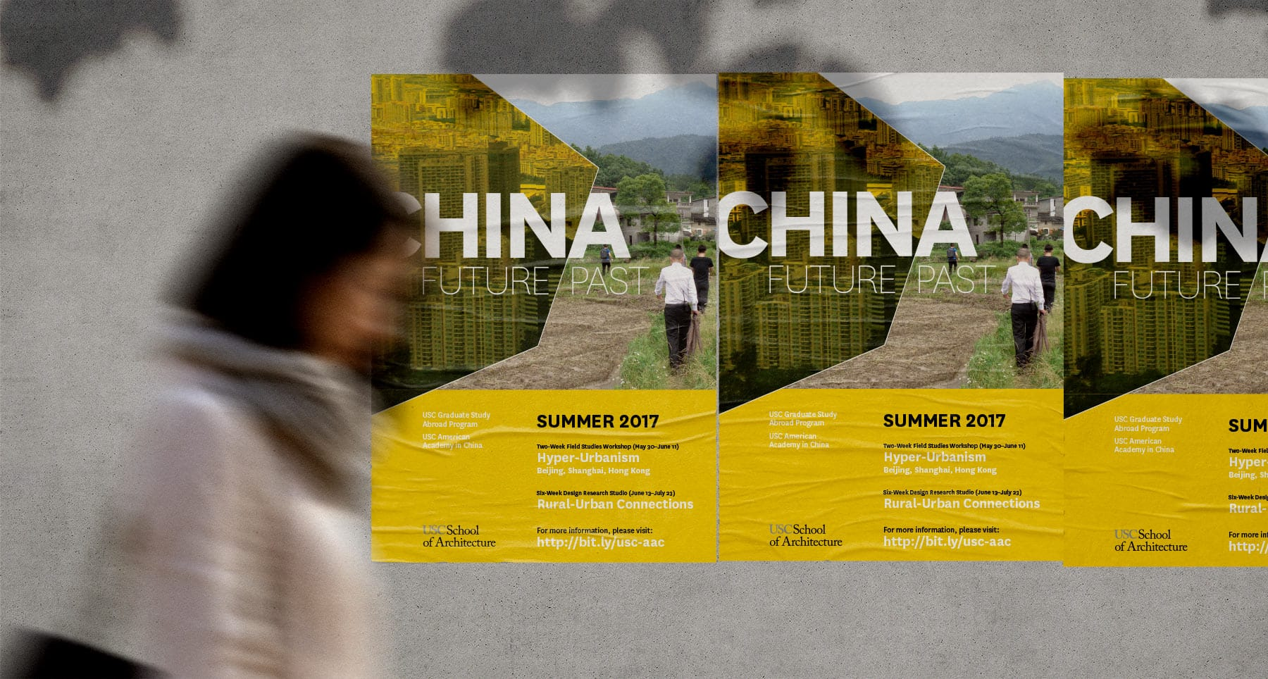 woman walking past a poster for the USC China program