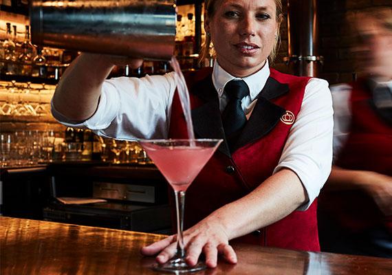 The Five Crowns restaurant logo on a bartender's uniform