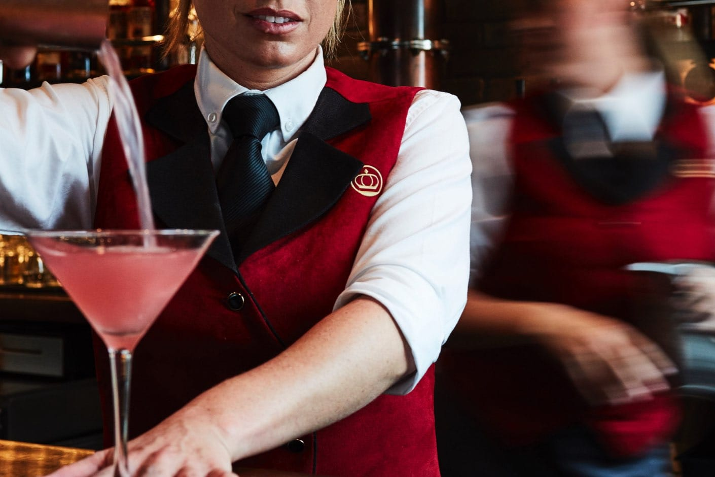 bartender pouring a pink martini
