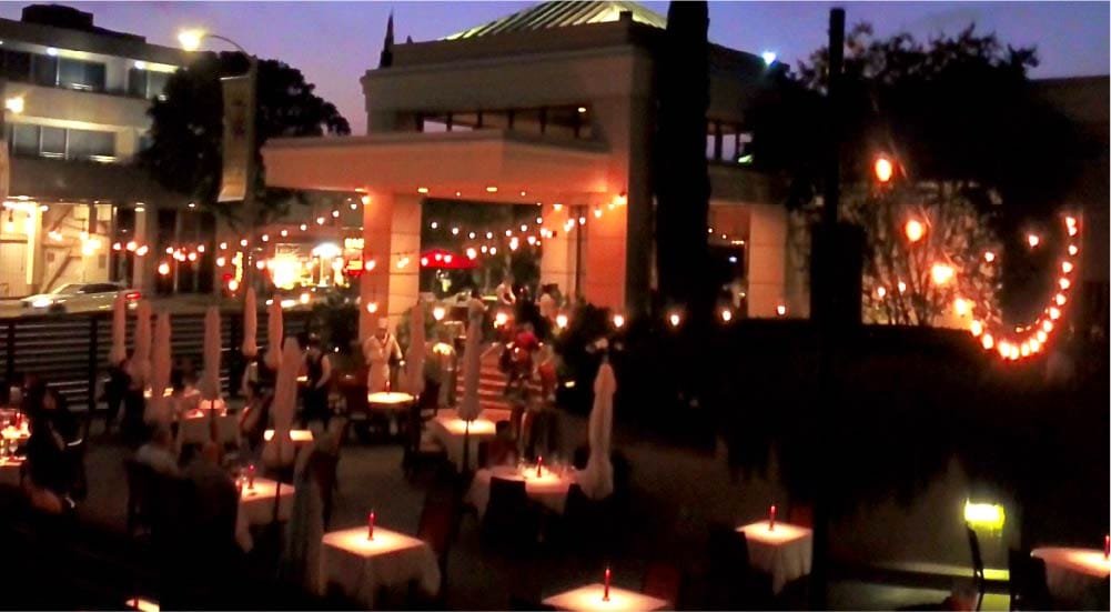 outdoor diners under twinkle lights